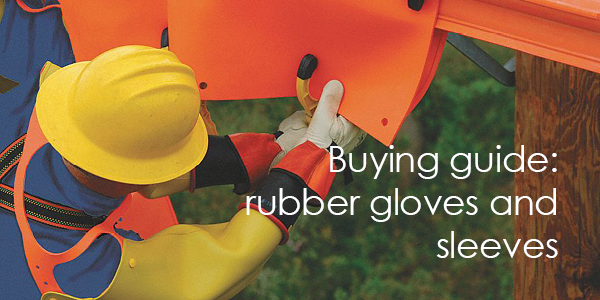 An electrical linesman wears rubber insulating gloves, sleeves and leather outer protectors
